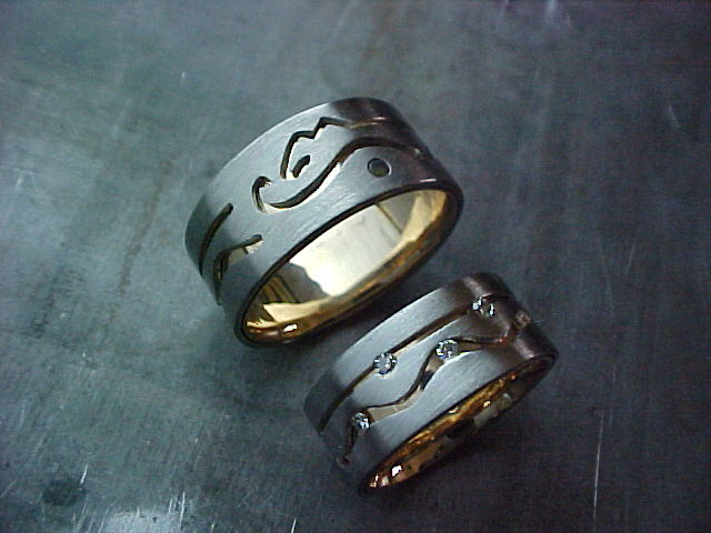 Calgary inspired custom wedding ring for the calgary stampede and matching wedding band with diamonds